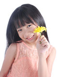 Portrait of young cute girl with yellow flower Royalty Free Stock Image