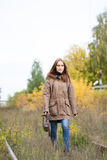Portrait of young cute woman in fall autumn park. Beautiful caucasian girl walking in forest Stock Images