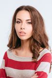 Portrait of a young cute woman looking at camera Royalty Free Stock Photography