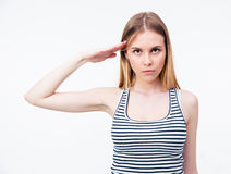 Portrait of a young cute woman saluting Royalty Free Stock Images