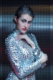 Portrait of young cyber woman in silver futuristic costume with bright makeup. stock photos