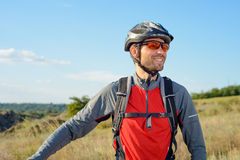 Portrait of Young Cyclist in Helmet and Glasses Royalty Free Stock Photo