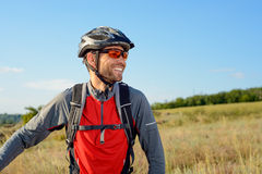 Portrait of Young Cyclist in Helmet and Glasses Stock Image