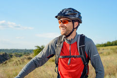 Portrait of Young Cyclist in Helmet and Glasses Royalty Free Stock Photos