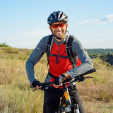 Portrait of Young Cyclist in Helmet and Glasses Stock Photo