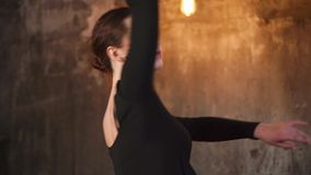 Portrait of a young dancer, who rehearses the room and turns around stock footage