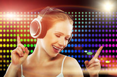 Portrait of a young dancing girl in headphones Stock Photo