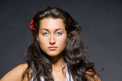 Portrait of young dark haired beautiful woman Stock Photos