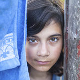 Portrait of a young dark-haired girl outdoors . Royalty Free Stock Image
