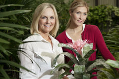 Portrait of a young daughter with senior mother in botanical garden Stock Image