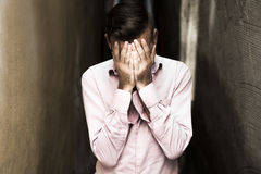 Portrait of young, depressed man in pain Stock Photography