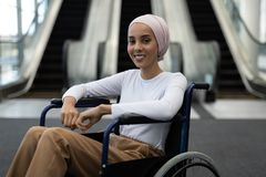 Beautiful disabled female executive in the lobby at office