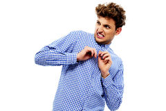 Portrait of a young disgusted man. Over white background stock photos