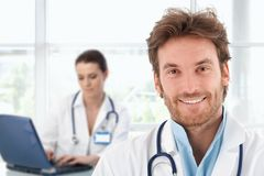 Portrait of young doctor at clinic Stock Images
