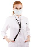 Portrait of a young doctor in mask. Studio shot over white background Stock Photos