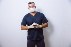 Portrait of young doctor with mask on a white background. Concept surgery and healthy stock images