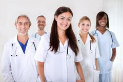 Portrait of a young doctor smiling with colleagues Stock Images