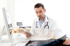 Portrait of a young doctor using tablet at work Stock Images