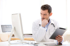 Portrait of a young doctor using tablet at work Royalty Free Stock Photography
