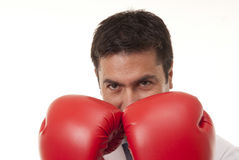 Portrait of young doctor wearing boxing gloves . Stock Photography