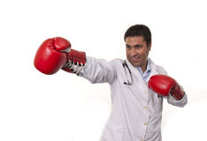 Portrait of young doctor wearing boxing gloves . Stock Photo