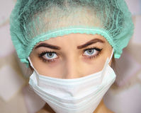 Portrait of a young doctor wearing a mask and hat Royalty Free Stock Images