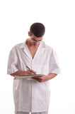 Portrait of young doctor writing a prescription Stock Photos