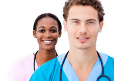 Portrait of young doctors standing in a row Royalty Free Stock Photos