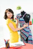 Dressmaker. Portrait of a young dressmaker looking at camera royalty free stock image
