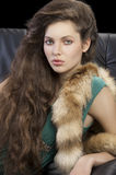 Portrait of young elegant girl with fur Royalty Free Stock Image