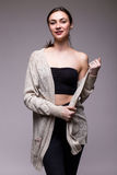 portrait young elegant woman in black clothes and grey jacket. Royalty Free Stock Images
