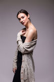 Portrait young elegant woman in black clothes and grey jacket. Royalty Free Stock Photography