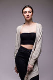Portrait young elegant woman in black clothes and grey jacket Stock Image