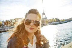 Portrait of young elegant woman on embankment in Paris, France Royalty Free Stock Images