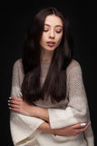 Portrait of young elegant woman in knitted sweater Stock Photography