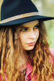 Portrait young elegant woman in pink coat and black hat. Fashion Stock Photo
