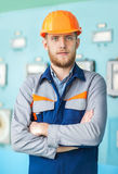 Portrait of young engineer at control room in factory Stock Photo