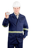 Portrait of young engineer holding a card. Portrait of young engineer in overalls and helmet holding a card isolated on white background Royalty Free Stock Photo