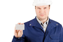 Portrait of young engineer holding a card. Portrait of young engineer in overalls and helmet holding a card isolated on white background Stock Photo