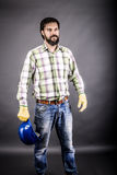 Portrait of young engineer holding his hardhat in one hand Royalty Free Stock Photography