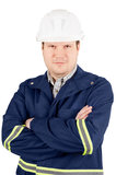 Portrait of young engineer. In overalls and helmet with hands folded against isolated on white background Stock Photo