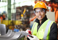 Portrait of young engineer taking notes stock image