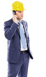Portrait of a young engineer talking on the phone Royalty Free Stock Images