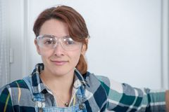 Portrait of young engineer woman with safety glasses. A portrait of young engineer woman with safety glasses Royalty Free Stock Photo
