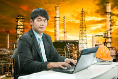 Portrait young engineering  man sittin and working on laptop com Stock Photo