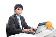 Portrait young engineering  man sittin and working on laptop com Stock Photography