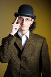 Portrait of young english gentleman in bowler hat. Close up portrait of young english gentleman in bowler hat and retro glasses stock photo