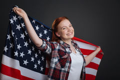 Portrait of young enthusiastic patriotic lady royalty free stock image