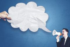 Young businessman with empty cloud bubble Royalty Free Stock Photos