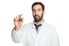 Portrait of young european doctor wit pill Royalty Free Stock Images